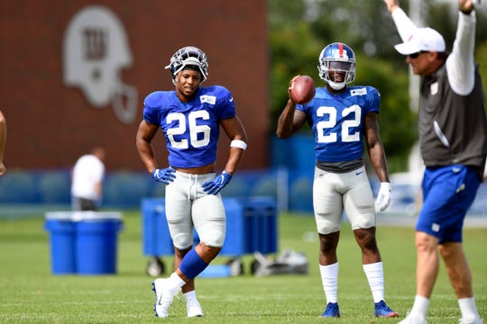New York Giants running backs Saquon Barkley (26) and Wayne Gallman Jr. (22) on the field during training camp on Monday, August 5, 2019, in East Rutherford.