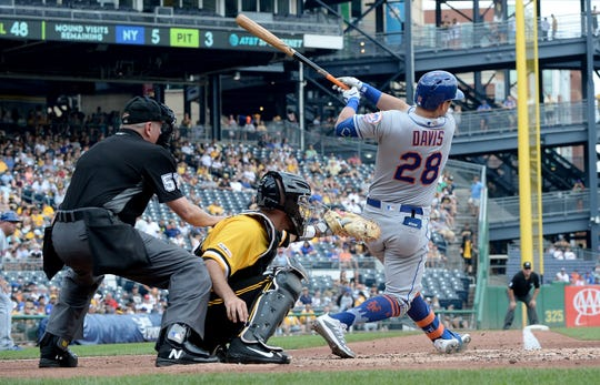 J.D. Davis #28 of the New York Mets hits an RBI single in the third inning during the game against the Pittsburgh Pirates at PNC Park on August 4, 2019 in Pittsburgh, Pennsylvania.