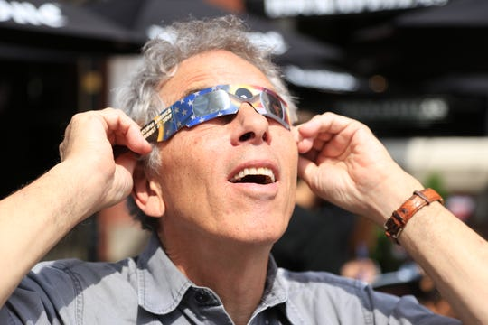 David Corcoran, a distinguished journalist who began his career at The Record, died Sunday, Aug. 4, at age 72. He is shown here viewing the solar eclipse in 2016, while associate director of the Knight Science Journalism Program at MIT.
