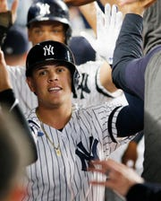 Aug 4, 2019; Bronx, NY, USA; New York Yankees third baseman Gio Urshela (29) is congratulated after hitting a two run home run against the Boston Red Sox during the third inning at Yankee Stadium.