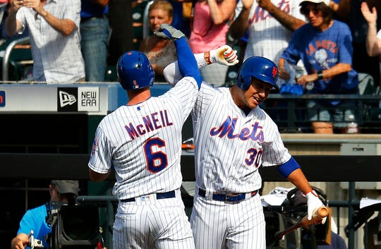 New York Mets second baseman Jeff McNeil (6) is congratulated by right fielder Michael Conforto (30) after hitting a solo home run against the Miami Marlins during the first inning of game one of a doubleheader at CitiField.