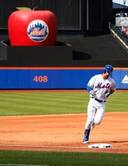New York Mets second baseman Jeff McNeil (6) rounds the bases after hitting a solo home run against the Miami Marlins during the first inning of game one of a doubleheader at CitiField.