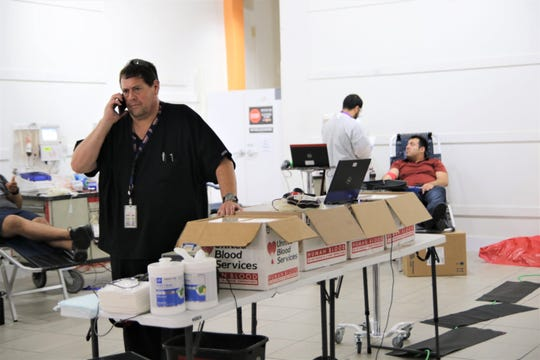 A Vitalant medic stands at the Mesilla Valley Mall blood donation site Saturday, Aug. 3, 2018.