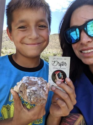 Ashley Montano stands with her son holding a gem stone they found that was hid by Drifter in Las Cruces.