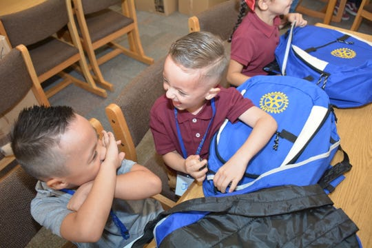 Desert Trails Elementary student Jon Hardin, left, and his kindergarten buddy Hector Rosales were giddy after receiving backpacks full of school supplies Monday, Aug. 5, 2019. The Anthony Rotary Club donated the backpacks.