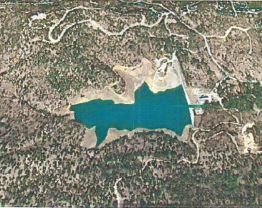 The photo shows an aerial view of Grindstone Dam and the reservoir created for drinking water and also used for recreation.