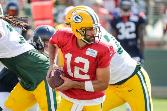 Green Bay quarterback Aaron Rodgers (12) takes a snap during a scrimmage at a joint training camp practice with the Texans at Ray Nitchske Field Monday, August 5, 2019, in Ashwaubenon, Wis.