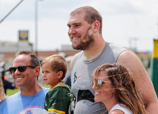 Texans tackle Max Scharping (74) meets with his fans after a joint training camp practice with the Green Bay Packers at Ray Nitschke Field Monday, August 5, 2019, in Ashwaubenon, Wis.