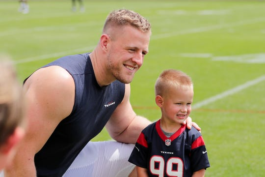 Texans defensive end J. J. Watt (99) greets fans after a joint training camp practice with the Green Bay Packers at Ray Nitchske Field Monday, August 5, 2019, in Ashwaubenon, Wis.