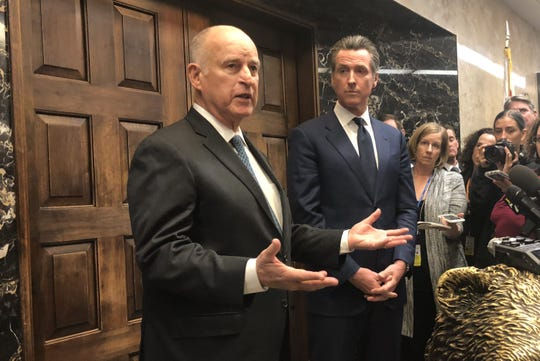 Jerry Brown, left, and Gavin Newsom, then governor and governor-elect of California, address the Capitol press on Nov. 13, 2018.