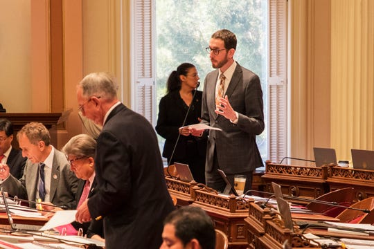 Sen. Scott Wiener, right, has reintroduced at least three measures that were vetoed by former Gov. Jerry Brown.