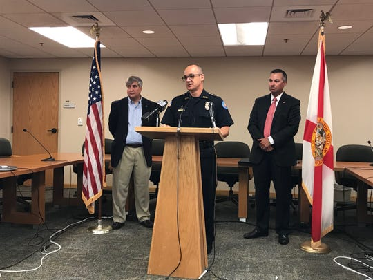 Pensacola Police Department Chief Tommi Lyter speaks Monday as Mayor Grover Robinson and Assistant U.S. Attorney Jeff Tharp listen at a press conference at Pensacola City Hall.
