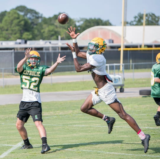 Damarius McGhee (6) intercepts a pass during football practice at Pensacola Catholic High School in Pensacola on Wednesday, July 31, 2019.