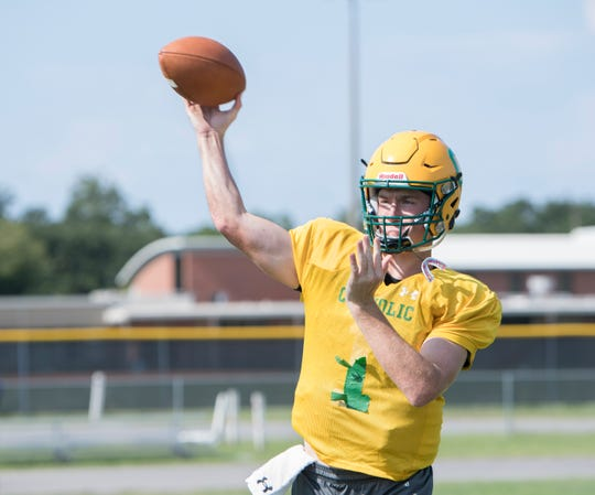 Quarterback Colin Whibbs (1) passes during football practice at Pensacola Catholic High School in Pensacola on Wednesday, July 31, 2019.