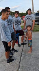 Six-year-old Gavin Carter meets some of the players on Navarre High School's football team at his birthday party Saturday.