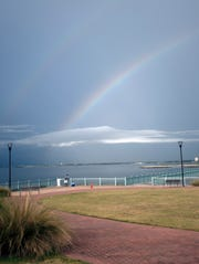 A double rainbow forms in the southwestern skies of Pensacola just before a  rainstorm passes over the area on Monday.