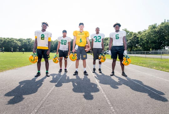 From left, Waymond Jordan (2), Nathan Williams (22), Colin Whibbs (1), Michael Archie (32), and Ja'kobi Jackson (5) during football practice at Pensacola Catholic High School in Pensacola on Wednesday, July 31, 2019.