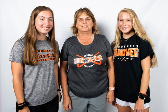 Hanover field hockey players Emily Crouse (left) and Ella Krenzer (right) pose for a photo with coach Gail Anderson in the GameTimePA photo booth during YAIAA fall sports media day in Hanover on Friday, August 2, 2019.