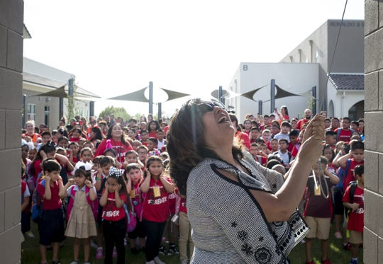 Principal Martha Jacobo rings the bell on the first day of school at Frank Elementary School in Guadalupe on August 5, 2019.