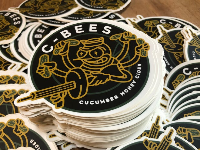 The C-Bees logo is a fun spin on the original Seabees logo, featuring cucumbers