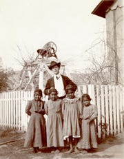 A teacher and four Guadalupe students pictured sometime in the early 1900s.
