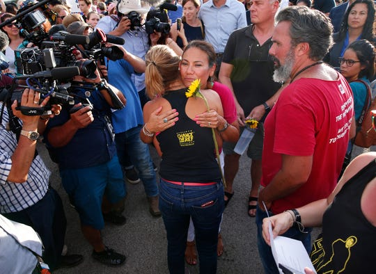 Rep. Veronica Escobar (D-El Paso) hugs Patricia Oliver after a silent march for victims of the Walmart shootings in El Paso August 4, 2019. Twenty people were killed and more than two dozen were injured in a mass shooting at Walmart on Saturday. Oliver lost her son, Joaquin, in the Marjorie Stoneman Douglas High School shooting in Parkland, FL. Today would have been his 19th birthday.