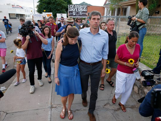 Democratic presidential candidate Beto O'Rourke walks with his wife, Amy Sanders O'Rourke (left) and Rep. Veronica Escobar (D-El Paso) in a silent march for victims of the Walmart shootings in El Paso August 4, 2019. Twenty people were killed and more than two dozen were injured in a mass shooting at Walmart on Saturday.