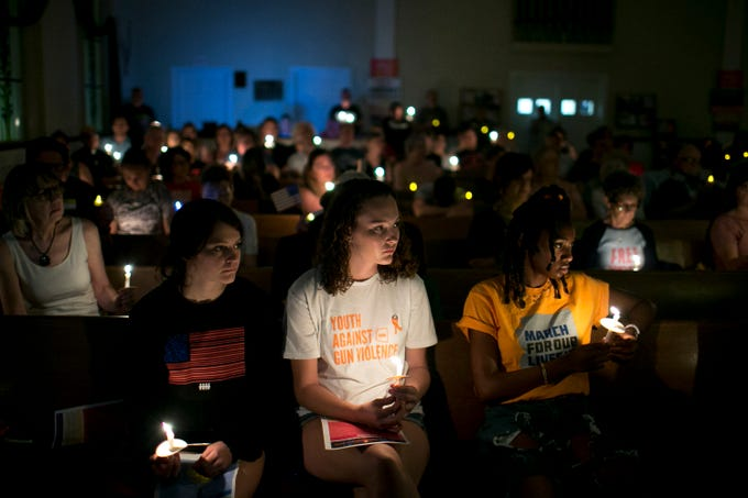 A vigil to honor the victims of recent mass shootings in Texas and Ohio is held at the First Congregational United Church of Christ in Phoenix on Aug 4, 2019.