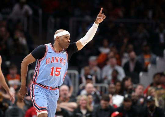 Feb 27, 2019; Atlanta, GA, USA; Atlanta Hawks forward Vince Carter (15) celebrates a three-point basket in the second quarter against the Minnesota Timberwolves at State Farm Arena. Mandatory Credit: Jason Getz-USA TODAY Sports