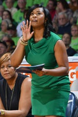 Notre Dame associate head coach Niele Ivey calls out instructions to her players during a game against Connecticut on Dec. 7, 2016.