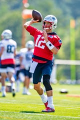 Jul 25, 2019; Foxborough, MA, USA; New England Patriots quarterback Tom Brady warms up during the 2019 season opening Training Camp at Gillette Stadium. Mandatory Credit: Ed Wolfstein-USA TODAY Sports