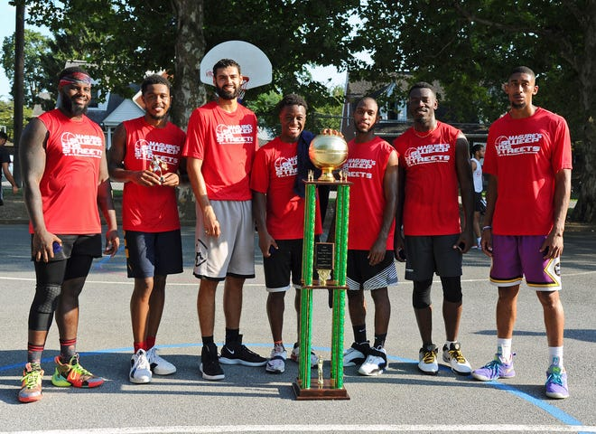 Members of Fuhrman Industrial pose with the championship trophy after capturing their second straight Sweep The Streets title on Sunday.