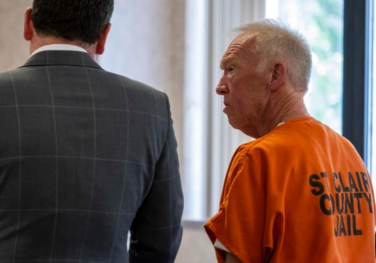 Richard Laurence Hartwick, right, listens while his attorney speaks during a hearing in St. Clair County Circuit Judge Michael West's courtroom Monday, Aug. 5, 2019. Hartwick, a former accountant with the Blue Water Center for Independent Living, has been charged with embezzling more than $1 million during his employment with the nonprofit.