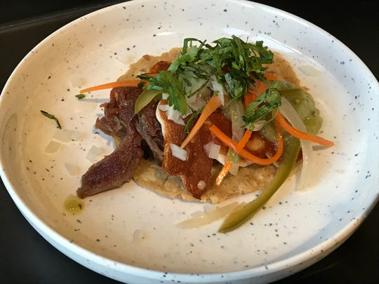 Pork shoulder and homemade corn tortillas anchor the carnitas tacos at the new Estella taqueria in the Jesse Hotel on East Fourth Street in Reno.