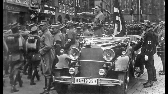 """The """"super"""" Mercedes-Benz specially built for Nazi leader Adolf Hitler had stylized design requirements specified by him for maximum protection. The vehicle came through Richmond on Aug. 12, 1948, on its way to a recruiting drive for the U.S. Air Force in Springfield, Ill. Armor plating protected the sides, and the undercarriage could be raised or lowered depending upon threat level."""