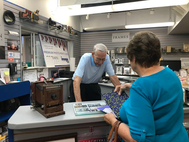 Crown Camera owner Gary Engell helps a customer on Monday, Aug. 5, 2019, at his downtown Redding store.