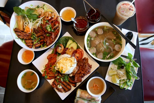 From left, vermicelli noodles combo bowl with grilled meats, a rice combo plate with grilled meats, salad rolls with shrimp and pork, a beef pho and a Vietnamese iced coffee at Super Pho in Salem on Aug. 5, 2019. The Vietnamese restaurant recently closed for a renovation ahead of its 10-year anniversary.