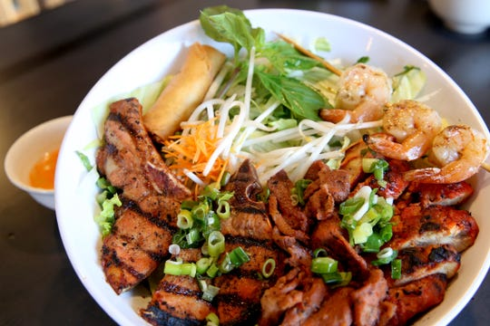 Vermicelli noodles served with grilled pork, pork chop, chicken and shrimp with an egg roll at Super Pho in Salem on Aug. 5, 2019. The Vietnamese restaurant recently closed for a renovation ahead of its 10-year anniversary.