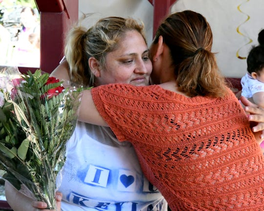 Lorena Pimentel de Salazar hugs a friend at the celebration for her daughter, Keyla, who was gunned down one week before her birthday. August 4, 2019.