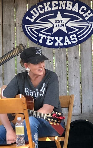 Lori Jo Thomas, a member of Lori Jo & Heroes of Honky Tonk, takes a break at a show in Luckenbach.