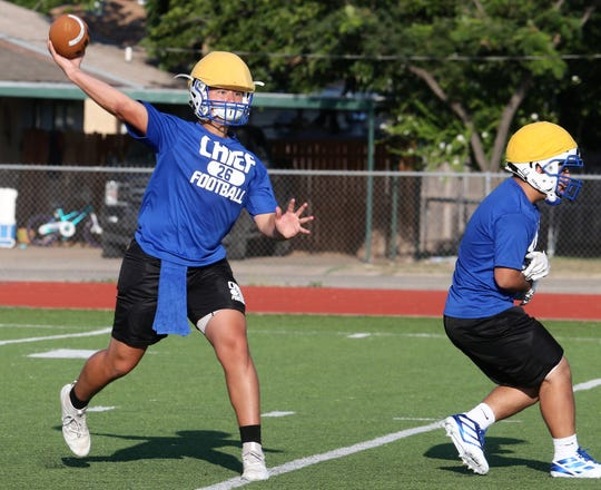 Lake View High School junior quarterback Albert Rodriguez gets ready to throw a pass during the start of workouts at Lake View on Monday, Aug. 5, 2019.