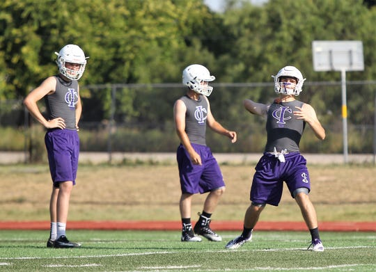 Irion County High School football players participate in passing drills during the first day of workouts Aug. 5, 2019 at Wolfenbarger Field in Mertzon.