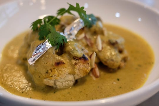 The Gobhi Musallam starts with pillowy roasted cauliflower that is coated in a rich, nutty yellow curry. For the royal touch, Raas tops it with edible silver.  Wednesday, July 31, 2019.