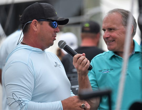 White Marlin Open official Andy Motsko interviews Rob Gothier after catching a 77.5-pound tuna on Monday, Aug. 5, 2019.
