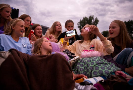 Friends from the Kairos Elite volleyball team hang out before the Verne Drive-In shows The Lion King, Friday, Aug. 2.