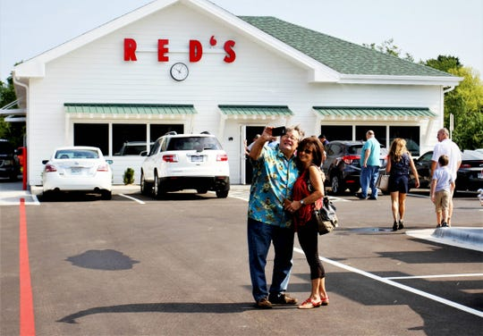 Kim and Becky Keith, of Ash Grove, snap a selfie in front of Red's Giant Hamburg Aug. 5, 2019. The couple said they were at the original Red's on its last day when it closed Dec. 14, 1984.