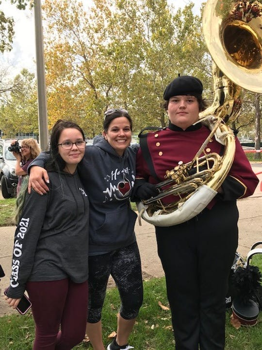 Crystal Tiarks, center, with her daughter Gracie and her son Braeden, who played tuba in the Watseka (Illinois) High School marching band. Braeden was killed Aug. 3 when another driver reportedly ran a red light.