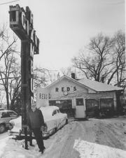 """Sheldon """"Red"""" Chaney is pictured in an undated photo standing next to the iconic sign outside his Route 66 diner, Red's Giant Hamburg. The restaurant was demolished in 1997. A revived version of the place opened Aug. 5, 2019 in west Springfield."""