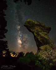 A view of Pedestal Rock in Arkansas, with the Milky Way glowing above it.