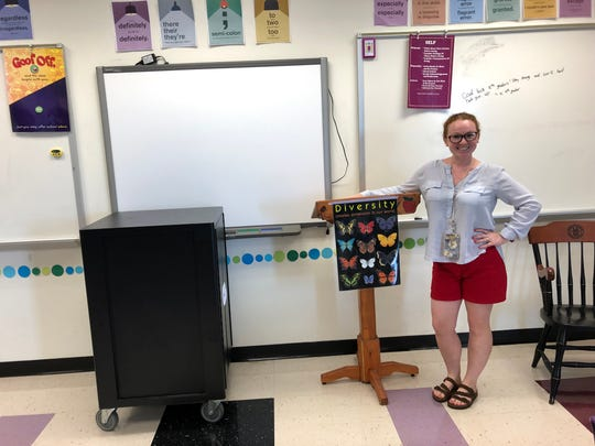 Kate Collins Middle School English teacher Jessica Sobelman stands in her classroom the day before the first day of the 2019-20 school year.